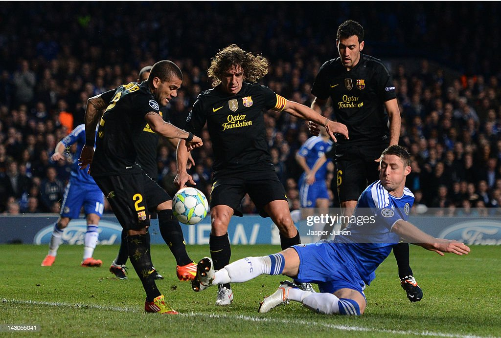 Gary Cahill of Chelsea challenges for the ball with Carles Puyol and Daniel Alves (L) of Barcelona during the UEFA Champions League Semi Final first leg match between Chelsea and Barcelona at Stamford Bridge on April 18, 2012 in London, England.