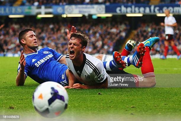 Gary Cahill of Chelsea challenges Scott Parker of Fulham during the Barclays Premier League match between Chelsea and Fulham at Stamford Bridge on...