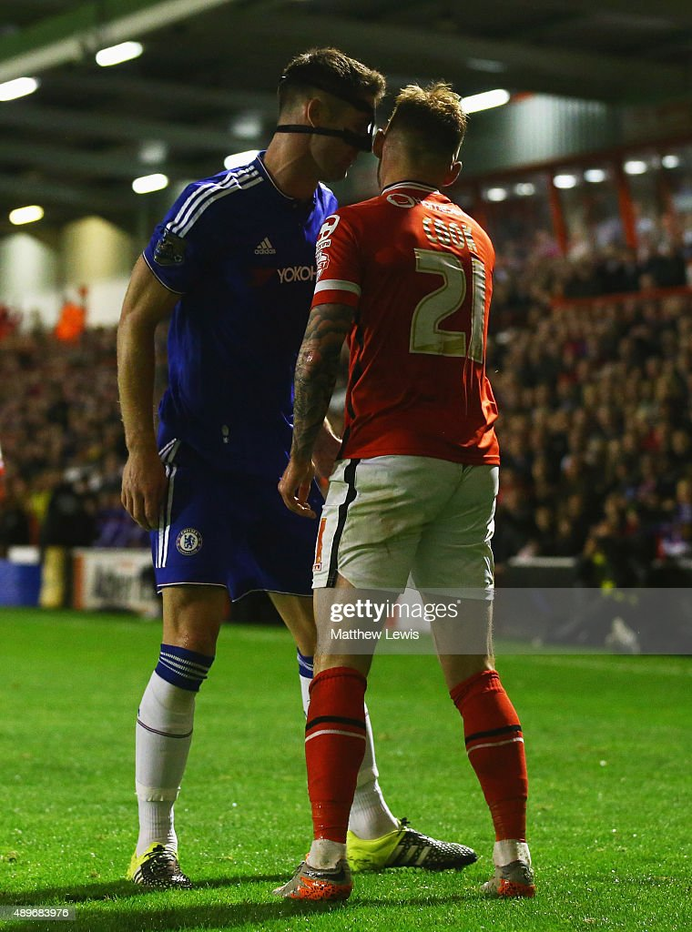 Gary Cahill of Chelsea clashes with Jordan Cook of Walsall during the Capital One Cup third round match between Walsall and Chelsea at Banks's Stadium on September 23, 2015 in Walsall, England.