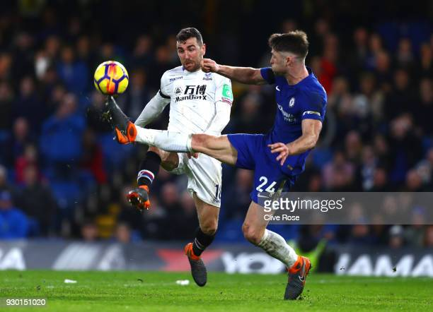 Gary Cahill of Chelsea controls the ball ahead of James McArthur of Crystal Palace during the Premier League match between Chelsea and Crystal Palace...