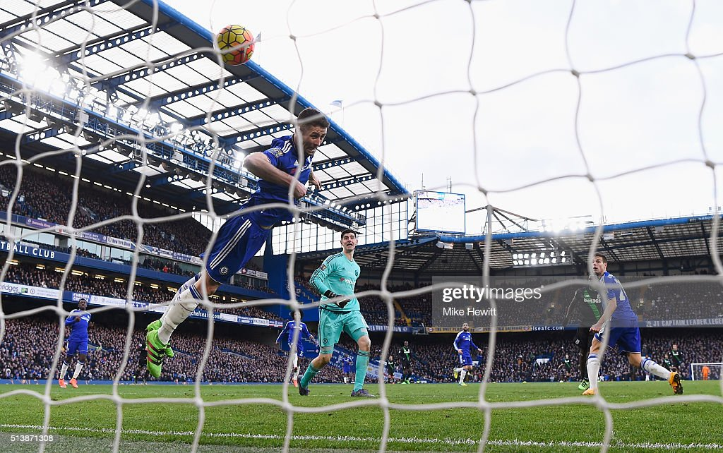 Gary Cahill of Chelsea fails to stop the header by Mame Biram Diouf of Stoke City during the Barclays Premier League match between Chelsea and Stoke City at Stamford Bridge on March 5, 2016 in London, England.