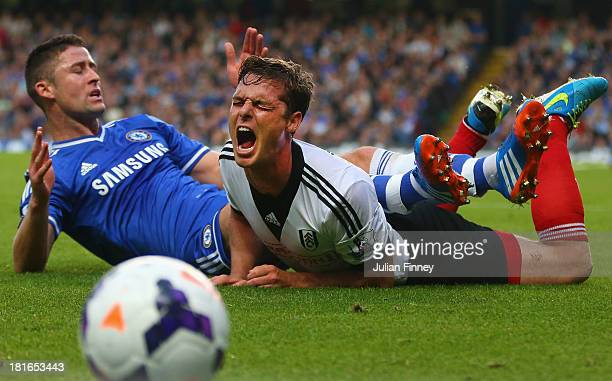 Gary Cahill of Chelsea fouls Scott Parker of Fulham during the Barclays Premier League match between Chelsea and Fulham at Stamford Bridge on...