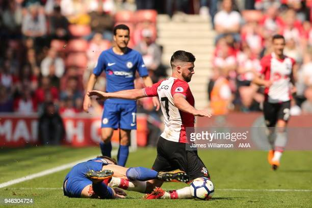 Gary Cahill of Chelsea fouls Shane Long of Southampton during the Premier League match between Southampton and Chelsea at St Mary's Stadium on April...
