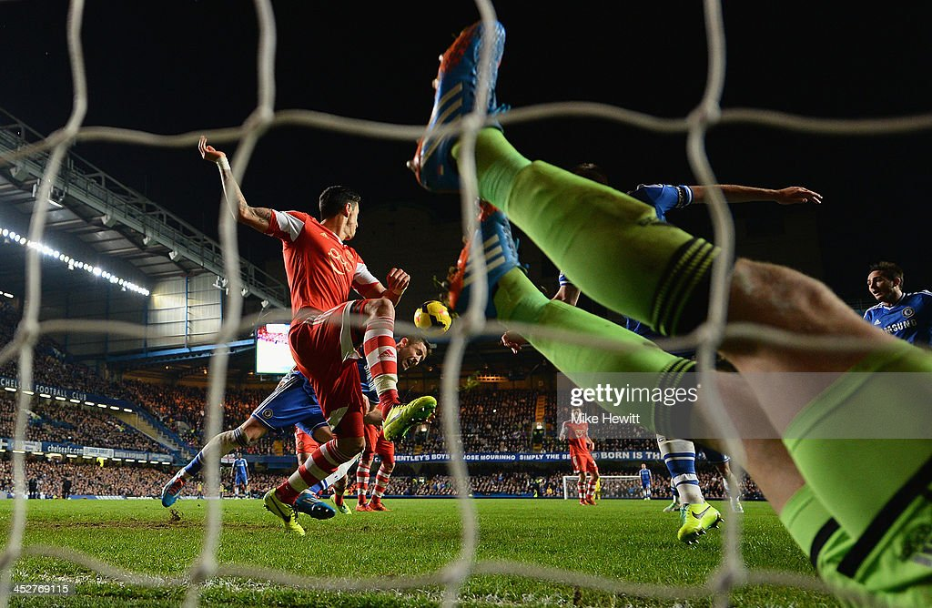 Gary Cahill of Chelsea heads his team's second goal as goalkeeper Artur Boruc of Southampton is stranded in the goal during the Barclays Premiership match between Chelsea and Southampton at Stamford Bridge on December 1, 2013 in London, England.