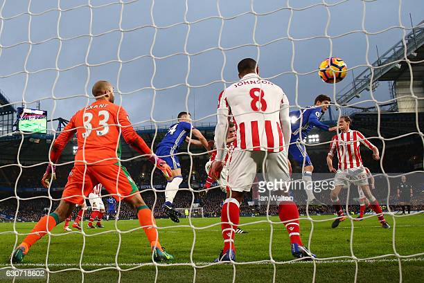 Gary Cahill of Chelsea heads to score the opening goal during the Premier League match between Chelsea and Stoke City at Stamford Bridge on December...