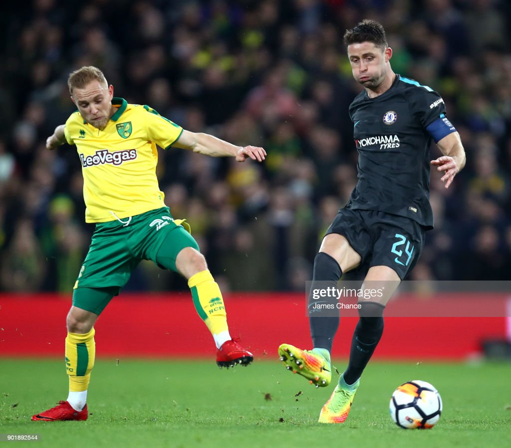 Gary Cahill of Chelsea is challenged by Alex Pritchard of Norwich City during The Emirates FA Cup Third Round match between Norwich City and Chelsea at Carrow Road on January 6, 2018 in Norwich, England.