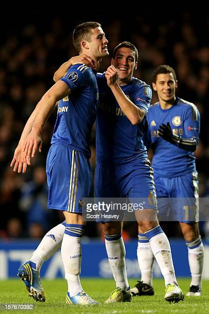 Gary Cahill of Chelsea is congratulated by teammate Oriol Romeu of Chelsea after scoring his team's third goal during the UEFA Champions League group...