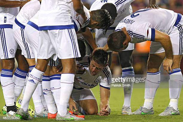 Gary Cahill of Chelsea is congratulated by teammates after scoring a goal against Barcelona in the second half during the International Champions Cup...