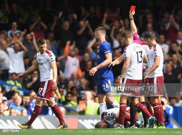 Gary Cahill of Chelsea is sent off by referee Craig Pawson after a challenge on Steven Defour of Southampton during the Premier League match between...