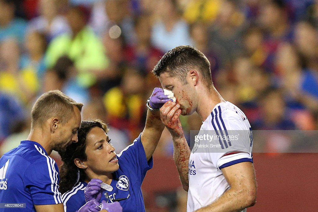 Gary Cahill #24 of Chelsea is tended to by medical staff after scoring a goal against Barcelona in the second half during the International Champions Cup North America at FedExField on July 28, 2015 in Landover, Maryland. Chelsea won in a penalty shootout.