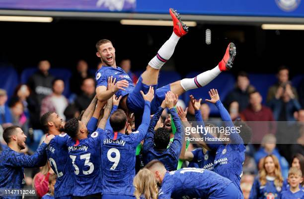 Gary Cahill of Chelsea is thrown in the air by team mates in celebration after the Premier League match between Chelsea FC and Watford FC at Stamford...
