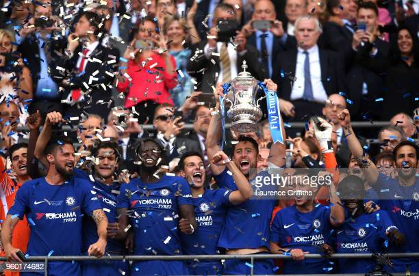 Gary Cahill of Chelsea lifts the Emirates FA Cup trophy following his sides victory in The Emirates FA Cup Final between Chelsea and Manchester...