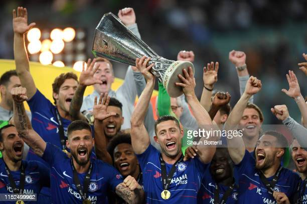 Gary Cahill of Chelsea lifts the Europa League Trophy with his team following victory in the UEFA Europa League Final between Chelsea and Arsenal at...