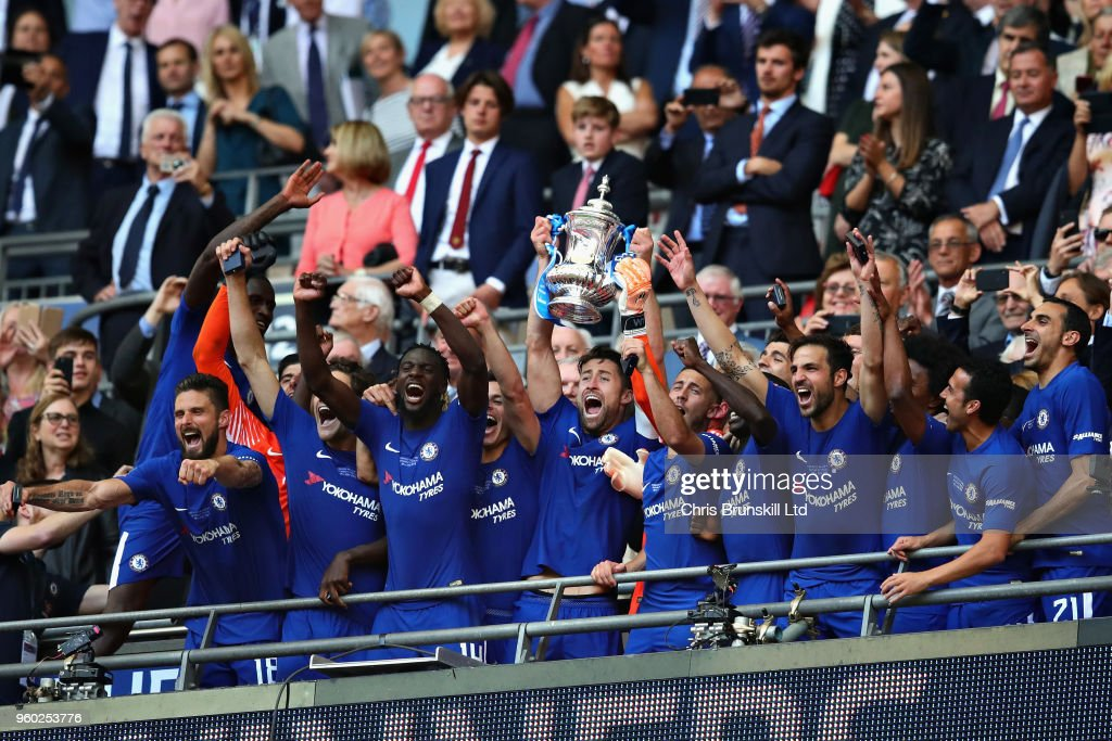 Gary Cahill of Chelsea lifts the FA Cup trophy after his side won during the Emirates FA Cup Final between Chelsea and Manchester United at Wembley Stadium on May 19, 2018 in London, England.