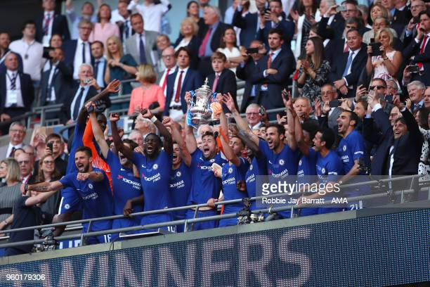 Gary Cahill of Chelsea lifts the trophy with his teammates and Chelsea Head Coach / Manager Antonio Conte at the end of the Emirates FA Cup Final...