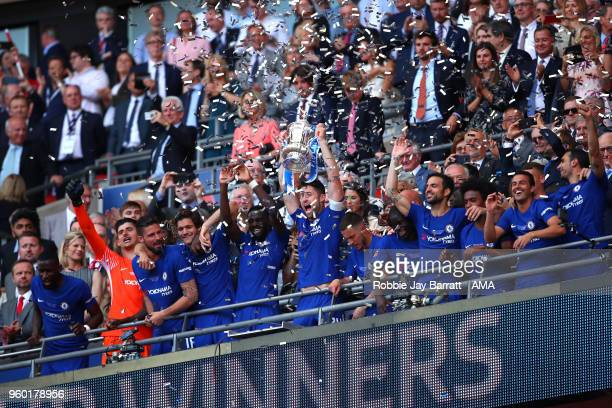 Gary Cahill of Chelsea lifts the trophy with his teammates at the end of the Emirates FA Cup Final between Chelsea and Manchester United at Wembley...