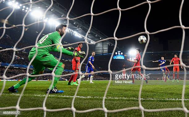 Gary Cahill of Chelsea scores his team's opening goal past goalkeeper Salvatore Sirigu of PSG during the UEFA Champions League Round of 16 second leg...