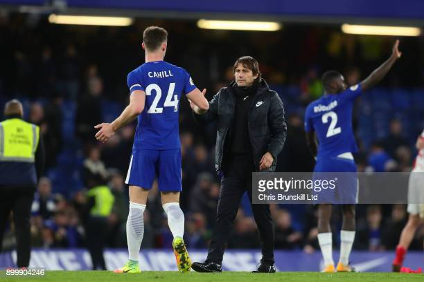 Gary Cahill of Chelsea shakes hands with manager Antonio Conte following the Premier League match between Chelsea and Stoke City at Stamford Bridge...