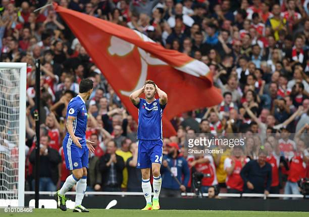 Gary Cahill of Chelsea shows dejection after Arsenal score during the Premier League match between Arsenal and Chelsea at the Emirates Stadium on...