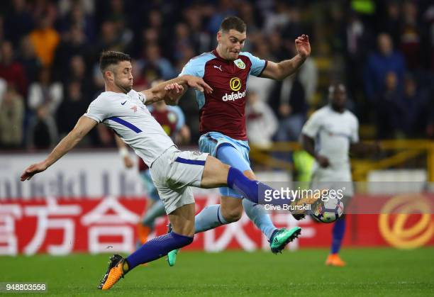 Gary Cahill of Chelsea tackles Sam Vokes of Burnley during the Premier League match between Burnley and Chelsea at Turf Moor on April 19 2018 in...