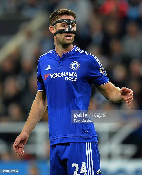 Gary Cahill of Chelsea wearing a face protector during the Barclays Premier League match between Newcastle United and Chelsea at St James' Park on...
