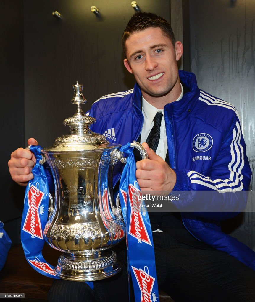 Gary Cahill of Chelsea with the trophy as he celebrates in the changing room after the FA Cup Final with Budweiser between Liverpool and Chelsea at Wembley Stadium on May 5, 2012 in London, England.