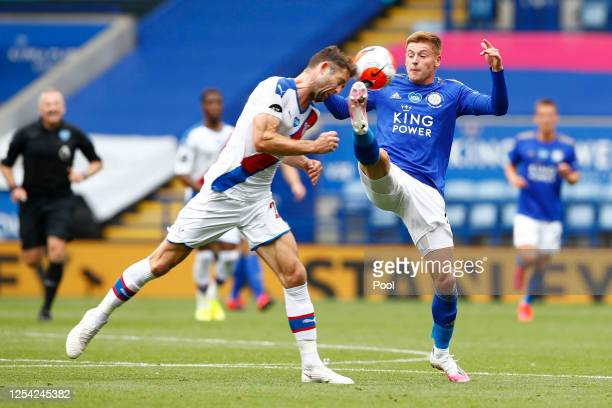 Gary Cahill of Crystal Palace and Harvey Barnes of Leicester City battle for the ball during the Premier League match between Leicester City and...
