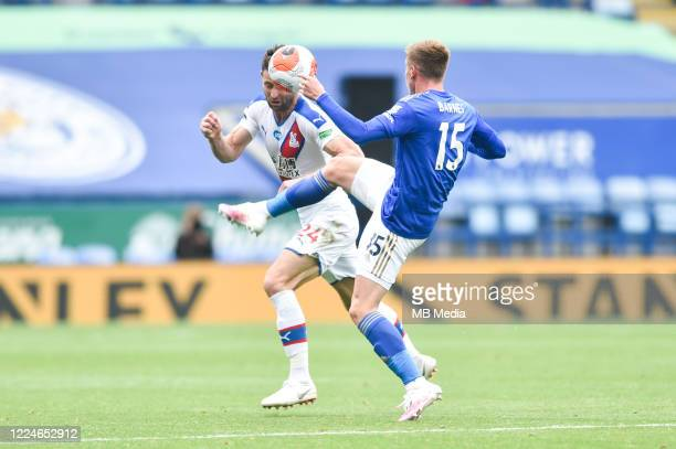 Gary Cahill of Crystal Palace attempts to head clear from Harvey Barnes of Leicester City during the Premier League match between Leicester City and...