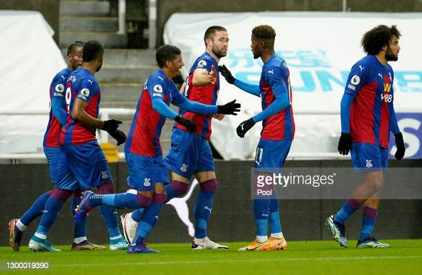 Gary Cahill of Crystal Palace celebrates with team mate Wilfried Zaha after scoring their side's second goal during the Premier League match between...