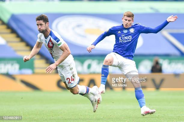 Gary Cahill of Crystal Palace clashes with Harvey Barnes of Leicester City during the Premier League match between Leicester City and Crystal Palace...