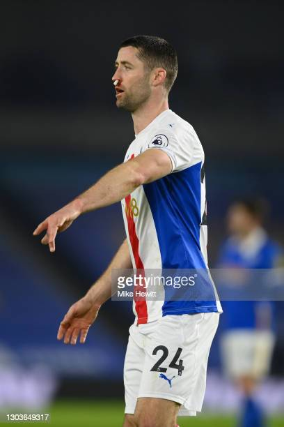 Gary Cahill of Crystal Palace gestures during the Premier League match between Brighton & Hove Albion and Crystal Palace at American Express...