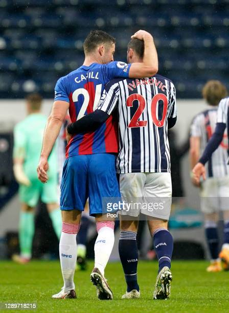 Gary Cahill of Crystal Palace interacts with Branislav Ivanovic of West Bromwich Albion following the Premier League match between West Bromwich...