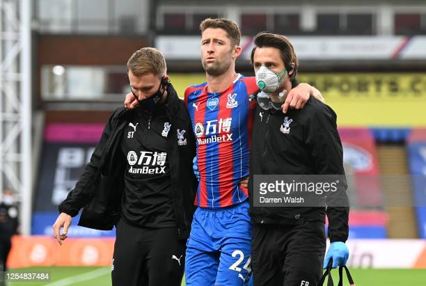 Gary Cahill of Crystal Palace leaves the pitch injured during the Premier League match between Crystal Palace and Chelsea FC at Selhurst Park on July...