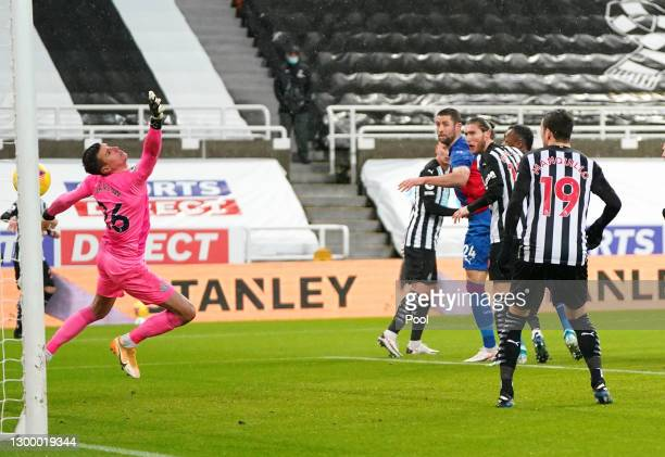 Gary Cahill of Crystal Palace scores their side's second goal past Karl Darlow of Newcastle United during the Premier League match between Newcastle...