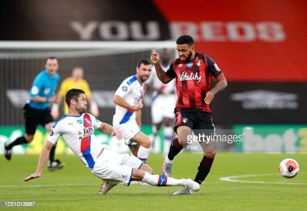 Gary Cahill of Crystal Palace tackles Joshua King of AFC Bournemouth during the Premier League match between AFC Bournemouth and Crystal Palace at...