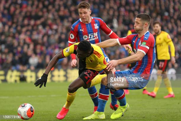 Gary Cahill of Crystal Palace tackling Ismaila Sarr of Watford during the Premier League match between Crystal Palace and Watford at Selhurst Park...