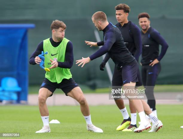 Gary Cahill of England attempts to tag Eric Dier of England with a toy chicken during the England training session on July 10 2018 in Saint...