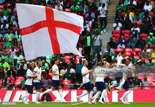 Gary Cahill of England celebrates scoring his sides first goal with team mates during the International Friendly match between England and Nigeria at...