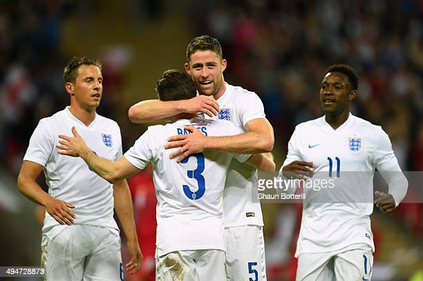 Gary Cahill of England celebrates scoring their second goal with Leighton Baines Phil Jagielka and Danny Welbeck of England uring the international...