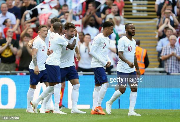 Gary Cahill of England celebrates with his team mates after scoring a goal to make it 10 during the International Friendly between England and...