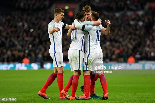 Gary Cahill of England celebrates with team mates after scoring their third goal during the FIFA 2018 World Cup qualifying match between England and...