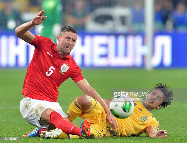 Gary Cahill of England fights for a ball with Edmar Halovskiy of Ukraine during their Brazil 2014 FIFA World Cup qualifiers Group H football match in...