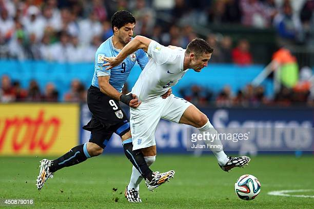 Gary Cahill of England holds off a challenge by Luis Suarez of Uruguay during the 2014 FIFA World Cup Brazil Group D match between Uruguay and...