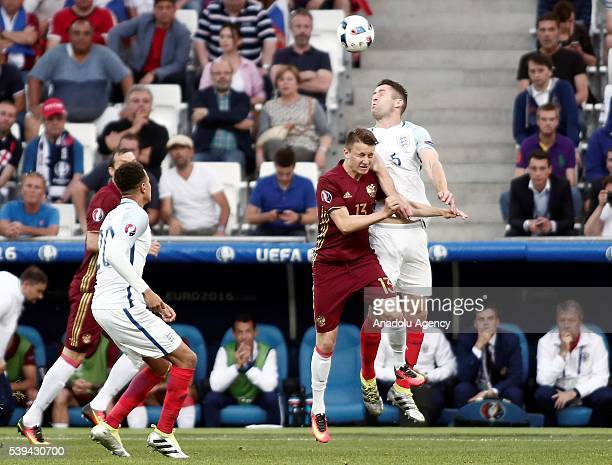 Gary Cahill of England in action against Aleksandr Golovin of Russia during Euro 2016 group B football match between England and Russia at Stade...