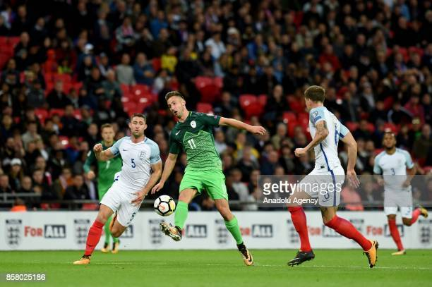 Gary Cahill of England in action against Andraz Sporar of Slovenia during the 2018 FIFA World Cup European Qualification football match between...