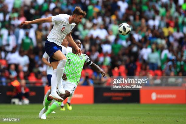 Gary Cahill of England in action with Odion Ighalo of Nigeria during an International Friendly between England and Nigeria at Wembley Stadium on June...