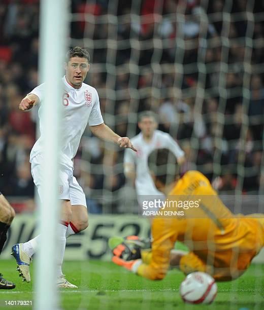 Gary Cahill of England scores past Dutch goalkeeper Maarten Stekelenburg during the International friendly football match between England and The...