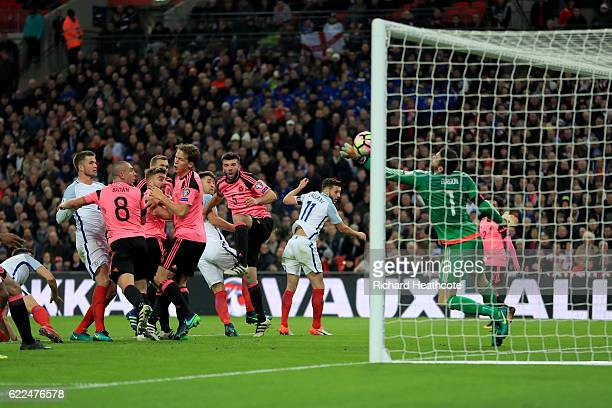 Gary Cahill of England scores their third goal past goalkeeper Craig Gordon of Scotland during the FIFA 2018 World Cup qualifying match between...