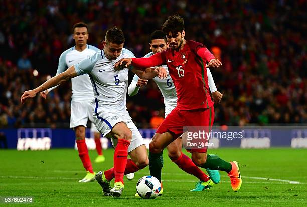 Gary Cahill of England tackles Andre Gomes of Portugal during the international friendly match between England and Portugal at Wembley Stadium on...