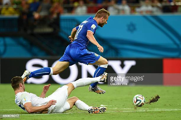 Gary Cahill of England tackles Ciro Immobile of Italy during the 2014 FIFA World Cup Brazil Group D match between England and Italy at Arena Amazonia...